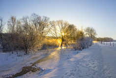 Frozen river in winter landscape Stock Photo