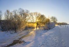 Frozen river in winter landscape stock photo