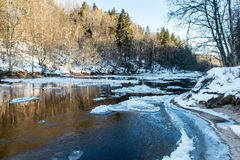 Frozen river in winter. With sandstone cliffs and ice blocks. Gauja National Park. Latvia Stock Photos