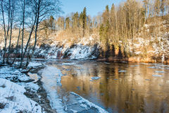 Frozen river in winter. With sandstone cliffs and ice blocks. Gauja National Park. Latvia Royalty Free Stock Photo