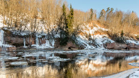 Frozen river in winter. With sandstone cliffs and ice blocks. Gauja National Park. Latvia Stock Image