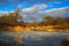 Frozen river in the winter at sunset. Ice royalty free stock photography