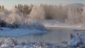 Frozen river in winter wonderland. Steaming frozen river in winter wonderland stock video