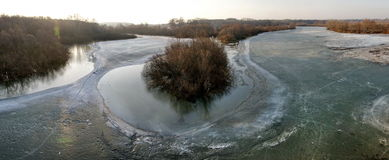 Frozen riverside panorama. Panorama of a frozen river with trees and small islands Royalty Free Stock Photo