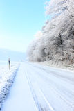 Frozen road. Frozen white road in a cold winter day Stock Photography