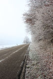 Frozen road. Frozen white road in a cold winter day Stock Photos
