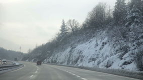 Frozen road and driving on a highway in winter time stock video footage