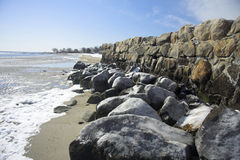 Frozen rocks. Overlooking a scenic winter beach Royalty Free Stock Photo