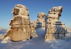 Frozen rocks on a mountain ridge in the morning light Royalty Free Stock Photos