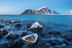 Frozen rocks on Skagsanden beach in Lofoten Norway. Frozen rocks on Skagsanden beach in Lofoten, Norway during winter stock photos
