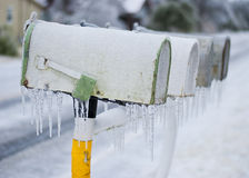 Frozen row of mailboxes Royalty Free Stock Photo