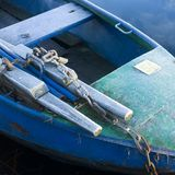 Frozen rowing boat. A steel rowing boat with subtle cool colors covered with a thin layer of frost Royalty Free Stock Image