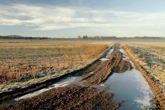 Frozen rural track at sunrise in autumn Royalty Free Stock Photo