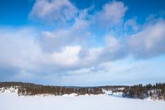 Frozen Saimaa lake under cloudy sky. Rural winter landscape, Finland stock photography