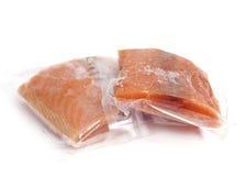 Frozen salmon. Two pieces of frozen salmon on white background Royalty Free Stock Photography