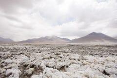 Frozen salt. Over the rocks on the bolvian desert stock photography