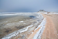 Frozen sand beach in winter Stock Photo