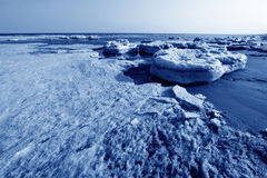 Coast residual ice natural scenery. Frozen sandy beach natural scenery in a geological park, north china Stock Photography