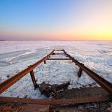 Frozen sea with broken pier Royalty Free Stock Photography