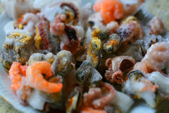 Frozen sea food ingredients. With shrimps, clams and octopuses Royalty Free Stock Photos
