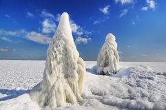 Frozen sea and huge boulders icicles on a pier. Stock Photography