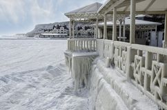 Frozen sea and ice-covered part of the summer cafe