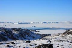Frozen Sea and Icebergs Stock Photo