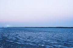 Frozen sea. The lighthouse, evening sky  romantic Royalty Free Stock Images