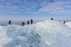 Frozen sea near Dutch coast and people exploring drifting ice. Beautiful winter day near Dutch coast and people exploring stacks of drifting ice Royalty Free Stock Images