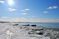Frozen sea. Sun is shining above blue sky and frozen sea Stock Image