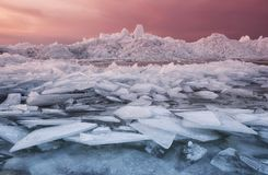 Frozen sea during sunset Stock Images
