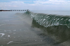Frozen sea wave. And pier stock photo