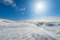 Frozen seashore in winter. With sun - Grisslehamn, Sweden Royalty Free Stock Photo