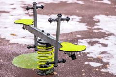 Frozen seesaw outdoors in a playground