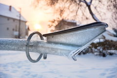Frozen seesaws covered with snow and ice Stock Images