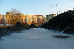 Frozen settlement. On a frozen puddle in winter Stock Image