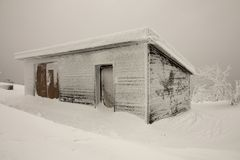 Frozen shack Stock Images