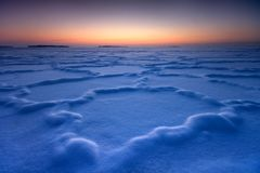 Frozen shapes in snowy ice Stock Image