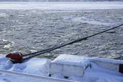 Frozen ship cable , old bollard at the pier in Royalty Free Stock Images