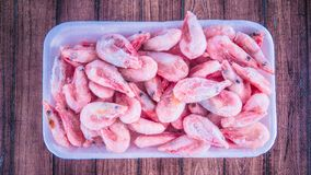 Frozen shrimps in ice. A lot of shrimp close-up. royalty free stock photos