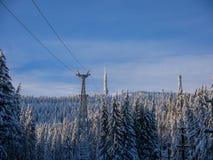 Frozen ski tow and radio antenna in the Carpathian mountains stock images
