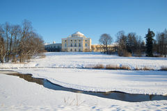 The frozen Slavyanka River and Pavlovsk palace in the sunny February afternoon. Vicinities of St. Petersburg, Russia Stock Photography