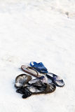 Frozen slippers near snow edge of ice hole Royalty Free Stock Image
