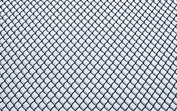 Frozen small chain-link fence pattern. Stock Images