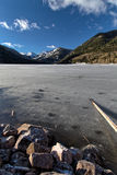 Frozen Smith and MoreHouse reservoir in Utah with log Stock Photo