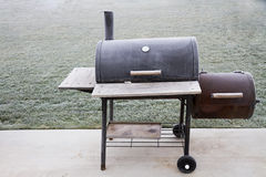 Frozen smoker. Wanting to bbq food but it's too cold outside Stock Images