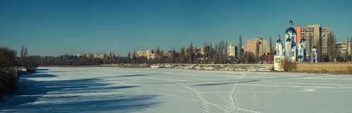 The frozen and snow-covered river Southern Bug and the Temple of the Holy Virgin. Ukraine, Vinnitsa Royalty Free Stock Photography