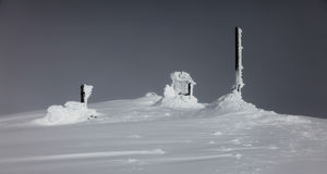 Frozen snow covering an old meteo station in Svalbard. Norway Stock Photo