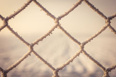 Frozen snow on metal fence Stock Image