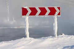 Frozen and snowed road sign Royalty Free Stock Photography